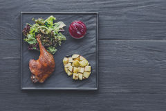 Roasted duck leg, restaurant food closeup Royalty Free Stock Photography