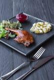 Roasted duck leg, restaurant food closeup Royalty Free Stock Image