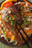 Roasted duck leg with rice noodles macro top view vertical Royalty Free Stock Photos