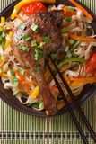 Roasted duck leg with rice noodles top view vertical Royalty Free Stock Image