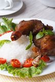 Roasted duck leg with rice and tomatoes close up vertical Royalty Free Stock Image