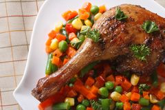 Roasted duck leg with vegetables top view horizontal Stock Images