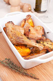 Roasted duck legs with herbs and potato Royalty Free Stock Photography