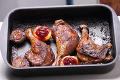 Roasted duck legs in pan Stock Image