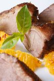 Roasted duck meat with orange and basil close-up vertical Royalty Free Stock Images