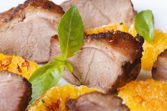 Roasted duck meat with orange macro horizontal top view Royalty Free Stock Image