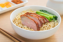 Roasted duck with noodles in bowl Stock Image
