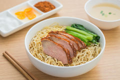 Roasted duck with noodles in bowl and soup Stock Photo
