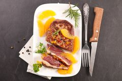 Roasted duck and oranges. Top view stock image