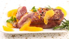 Roasted duck and oranges royalty free stock photo