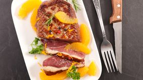 Roasted duck and oranges royalty free stock image
