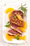 Roasted duck and oranges stock images