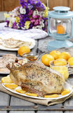 Roasted duck with oranges on wooden table Royalty Free Stock Photography