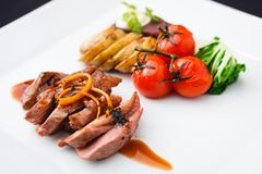 Roasted duck with pear Royalty Free Stock Images