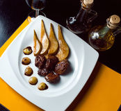 Roasted duck with pear,marinated in red wine and Royalty Free Stock Photography