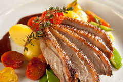 Roasted duck in port wine sauce. Royalty Free Stock Photography