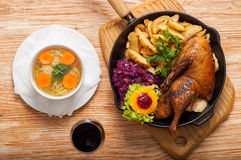 Roasted duck and potato wedges stock photo