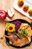 Roasted duck and potato wedges Royalty Free Stock Images