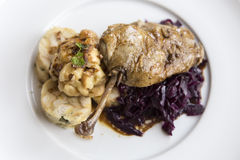 Roasted duck with red cabbage. Delicious roasted duck with red cabbage and dumplings Stock Images