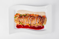 Roasted duck with rice, jasmine and chili sauce on white plate b Stock Photos