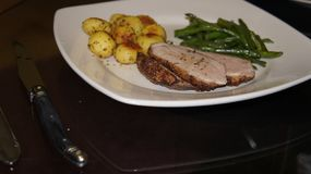Roasted duck with rosemary potatoes and beans. stock photos