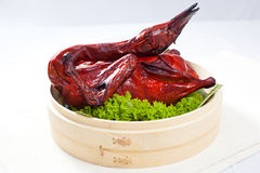 Roasted Duck Specialties - 7th Lunar Month. Whole duck signifies rebirth, togetherness, and prosperity. steam or boil the chicken with the head and feet still Stock Image