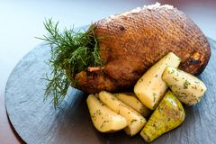 Roasted duck with sweet pears. Royalty Free Stock Photography