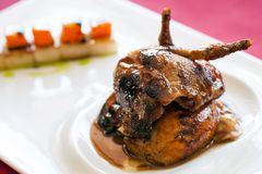 Roasted duck thighs with fruit. Stock Photo