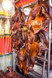 Roasted Ducks Hanging On Food Stall At Street Market Stock Photo