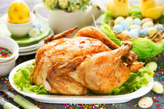 Roasted Easter chicken on Easter table Royalty Free Stock Image