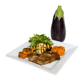 Roasted eggplant. Grilled eggplant and meat, sweet potatoes and salad Royalty Free Stock Image