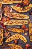 Roasted eggplants on baking tray top Stock Image