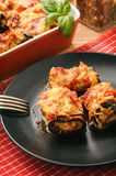 Roasted eggplants stuffed with minced meat and baked with tomatoes and cheese. Stock Photography