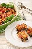 Roasted eggplants stuffed with minced meat and baked with tomatoes and cheese. Royalty Free Stock Photography