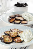 Roasted eggplants with tzatziki Stock Photo