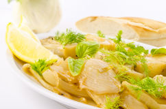 Roasted fennel discs with limes Royalty Free Stock Image