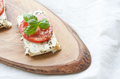 Roasted feta with tomatoes royalty free stock photography