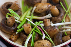 Roasted field mushrooms, champignons being cooked in frying pan Stock Photo