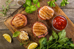 Roasted filet mignon with herbs and spices. Rustic wood background Royalty Free Stock Image