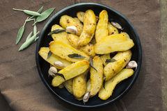 Roasted Fingerling Potatoes with Sage Leaves and Garlic Royalty Free Stock Photo