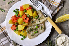 Roasted fish fillet with thyme and vegetable garnish. Stock Photography