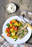 Roasted fish fillet with thyme and vegetable garnish. Royalty Free Stock Photos