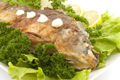 Roasted fish with fresh herbs and lemon. Selective focus Stock Images