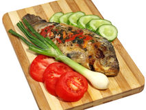 Roasted fish and fresh vegetables. Stock Photo