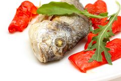 Roasted fish with garnish Stock Images
