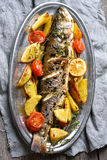 Roasted fish with potato wedges. And vegetables, top view Stock Photography