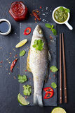 Roasted fish with sauces, fresh herbs and lime Royalty Free Stock Photos