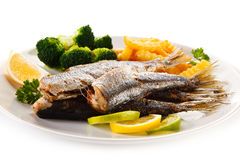 Roasted fish and vegetables Royalty Free Stock Photos