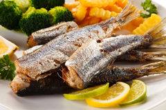 Roasted fish and vegetables Stock Photo