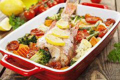 Roasted fish with vegetables Royalty Free Stock Image